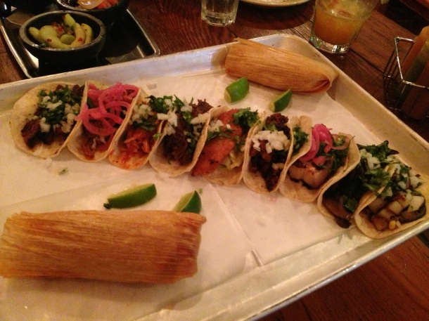 Photo by Alexa Large Platter - 9 tacos, 2 tamales, cucumber salad, chipotle slaw, small guacamole & tortilla chips