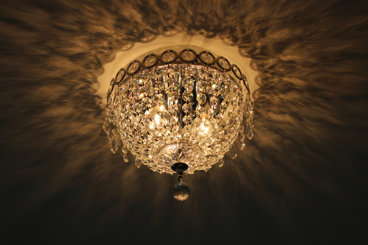Elegant, vintage chandelier draped in crystals adds the finishing touch! Photo by Alexa